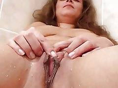 Mature shaved and masturbate her large lips by Pm-82