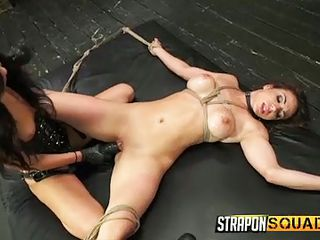 lesbo with strap on has fun