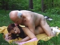 An old dude fucks a beautiful hotbitch in the forest