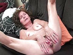 Granny in stockings masturbates